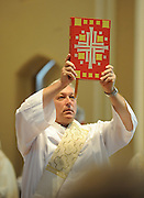 A deacon at St. Mary Church, Appleton, carries the Book of Gospels. (Sam Lucero photo)