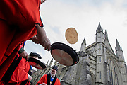 UNITED KINGDOM, Winchester: 05 March 2019 Winchester Pancake Race Photo Feature:<br /> Competitors practice flipping pancakes before the Inaugural Winchester Pancake Race earlier this afternoon on Shrove Tuesday. The race, which consisted of 20 teams, took place in the gardens surrounding Winchester Cathedral. <br /> Rick Findler / Story Picture Agency