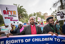 """16 June 2017, Nairobi, Kenya: Bishop Stephen Marete (middle). On 16 June, more than 500 people gathered to commemorate the Day of the African Child in Nairobi, Kenya, and to speak up publicly for the rights of children and adolescents living with HIV. Religious leaders from a range of different faith communities and traditions led a march through the streets of Nairobi, from the All Saints Cathedral to Ufungamano House, accompanied by hundreds of youth and young children from local faith-sponsored schools, after which a ceremony was held where the religious leaders committed publicly to work for children's rights to HIV testing, access to treatment, and freedom from stigma and discrimination, to make sure that those who are in need of treatment are also able to stay on treatment. The day was organized by the World Council of Churches Ecumenical Advocay Alliance together with Inerela+ Kenya, with contributions from a range of other partners. At end of the ceremony, the WCC-EAA launched a global Call to Action entitled """"Act now for children and adolescents living with HIV"""", which was signed by the range of religious leaders."""