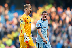 Joe Hart and James Milner of Manchester City leave the pitch after the match ends 1-1 - Photo mandatory by-line: Rogan Thomson/JMP - 07966 386802 - 21/08/2014 - SPORT - FOOTBALL - Manchester, England - Etihad Stadium - Manchester City v Chelsea FC - Barclays Premier League.