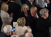 President Donald Trump greets Hillary Clinton in Statuary Hall in the U.S. Capitol for the Inaugural Luncheon following Donald Trump's inauguration as the 45th President of the United States, in Washington, DC, on January 20, 2017.