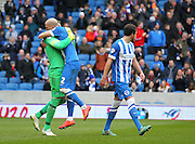 Brighton's Goalkeeper David Stockdale is congratulated after his penalty save by Brighton's Bruno Saltor during the Sky Bet Championship match between Brighton and Hove Albion and Birmingham City at the American Express Community Stadium, Brighton and Hove, England on 21 February 2015. Photo by Phil Duncan.