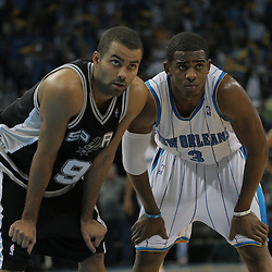 17 December 2008: New Orleans Hornets guard Chris Paul (3) and San Antonio Spurs guard Tony Parker (9) wait for play to resume during a NBA regular season game between the Western Conference rivals the San Antonio Spurs and the New Orleans Hornets at the New Orleans Arena in New Orleans, LA..