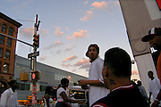 Residents of Spanish Harlem congregate outside a subway station at E 125th St, Summer 2005.