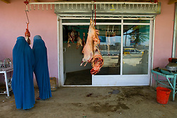 Women shop at a butcher shop in Kabul, Afghanistan. (Photo © Jock Fistick)