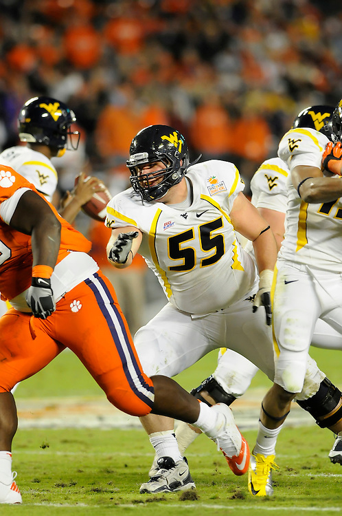 January 4, 2012: Tyler Rader #55 of West Virginia in action during the NCAA football game between the West Virginia Mountaineers and the Clemson Tigers at the 2012 Discover Orange Bowl at Sun Life Stadium in Miami Gardens, Florida.