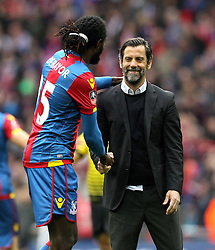 Watford Manager Quique Flores shakes the hand of Emmanuel Adebayor of Crystal Palace at full time - Mandatory by-line: Robbie Stephenson/JMP - 24/04/2016 - FOOTBALL - Wembley Stadium - London, England - Crystal Palace v Watford - The Emirates FA Cup Semi-Final