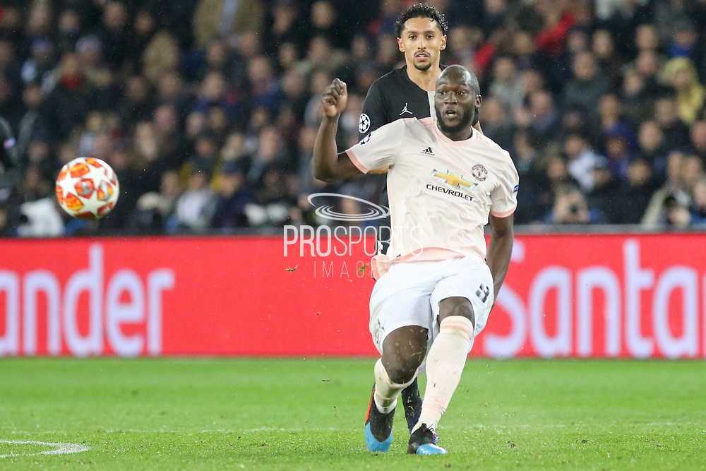 Manchester United Forward Romelu Lukaku crosses the ball during the Champions League Round of 16 2nd leg match between Paris Saint-Germain and Manchester United at Parc des Princes, Paris, France on 6 March 2019.