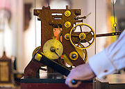 "© Licensed to London News Pictures. 23/10/2014. Guildford, UK. Michael Tooke changes the time mechanism on a turret clock.  clock in the shop. As British Summer Time comes to an end, staff at Horological Workshops start the task of changing the 100's of clocks at their store in Guildford, Surrey, UK. Michael Tooke who has owned the store for over 40 years and worked in the clock business all his life said. ""at this time of year we get a lot of people who bring clocks in for repair after they have changed the time incorrectly by winding back the hands manually"". Clocks change on Sunday morning 26th October. Photo credit : Stephen Simpson/LNP"