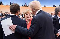 07 JUL 2017, HAMBURG/GERMANY:<br /> Emmanuel Macron (L), Praesident Frankreich, Angela Merkel (M), CDU, Bundeskanzlerin, und Donald Trump (R), Praesident Vereinigte Staatsn von America, USA, im Gesprech, vor Beginn der 1. Arbeitssitzung, G20 Gipfel, Messe<br /> IMAGE: 20170707-01-033<br /> KEYWORDS: G20 Summit, Deutschland, Gespr&auml;ch