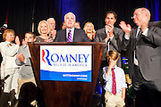 28 FEBRUARY 2012 - PHOENIX, AZ:    US Senator JOHN McCAIN flanked by members of the Romney family and Arizona Republican politicians, speaks in support of Mitt Romney at a Romney election watch party in Phoenix. Several hundred Romney supporters crowded into a ballroom in a Phoenix hotel to watch primary results from Michigan and Arizona. Romney won the night, scoring a tight win in the Michigan Republican Presidential primary and a comfortable win in the Arizona Republican Presidential primary.     PHOTO BY JACK KURTZ