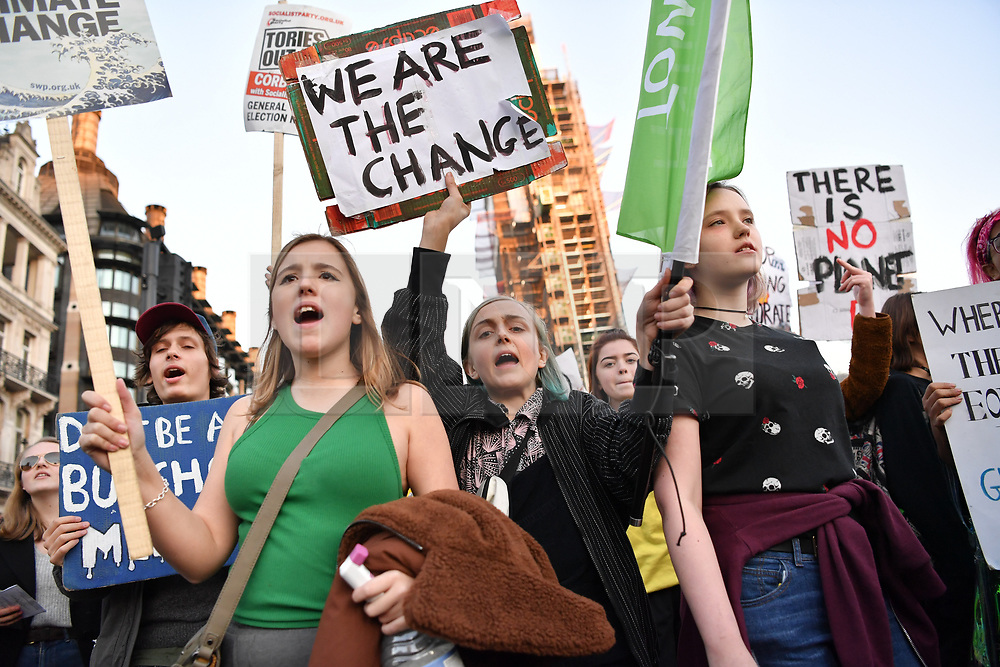 © Licensed to London News Pictures 15/02/2019 London, UK. At the close of a day of protest, students who took the day off school to protest inaction over climate change move from Parliament Square to Westminster Bridge and stage a sit-down blocking traffic at rush hour. Photo credit: Guilhem Baker/LNP