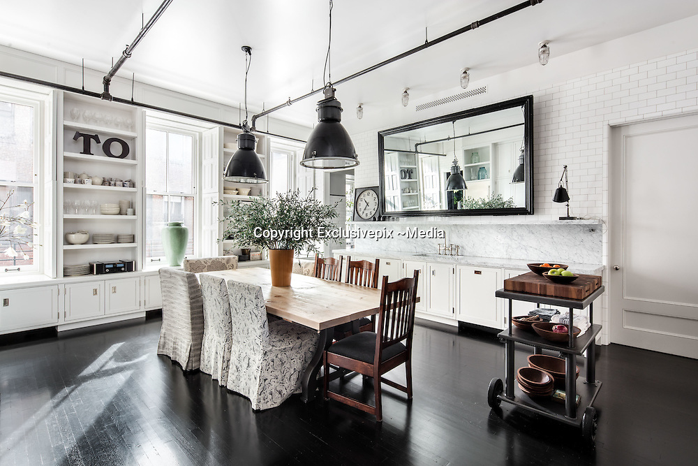 """EXCLUSIVE<br /> Meg Ryan home – her US$10.9 million Soho loft - <br /> <br /> Fifteen years ago actress Meg Ryan attended a party in a New York loft, almost four years ago she bought it, and now, after completely gutting and remodelling it, she is selling it for US$10.9 million.<br /> <br /> Meg, the """"When Harry Met Sally"""" star, had moved to New York from California after her divorce from actor Dennis Quaid. After first living in 5 rented properties with her daughter Daisy, she decided she needed a permanent home.<br /> <br /> As soon as she stepped into the 380 sq.m loft while house hunting, she remembered being at a party there. """"It was all quite different back then, and the space had been through many eras,"""" she recalls. At one point the former button factory had been a photo studio. """"When I had visited all those years ago, I was amazed by the volume. It was like so much of New York: cinematic. That's what attracted me.""""<br /> <br /> She bought the loft from """"The Simpsons"""" actor Hank Azaria, and set about renovating it – the ninth property she has redecorated. She gave it a major face lift. Now, a black and white colour scheme dominates the three bedroom, three bathroom property. <br /> <br /> The home's entrance features a 12 metre long gallery flooded with light from 5 huge windows (the loft features 13 oversized windows in total) and featuring several original architectural columns. Floor-to-ceiling French doors lead into the living room with its high ceilings, ebony wood floors and a decorative fireplace.<br /> The home also features a large eat-in kitchen, illuminated with lights Meg found in a salvage shop in Maine, a media room, a butler's pantry and a laundry room. The master bedroom has no less than eight closets and a free-standing bathtub in the ensuite bathroom.<br /> <br /> """"I love renovating,"""" says Meg. """"I think it's tied to living the actor's life. As an actor, you are so rarely in control. You're always saying words that someone else has given you"""