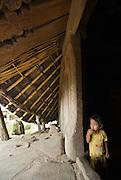 Young boy at door of traditional Manggarai house, Todo Village, Flores