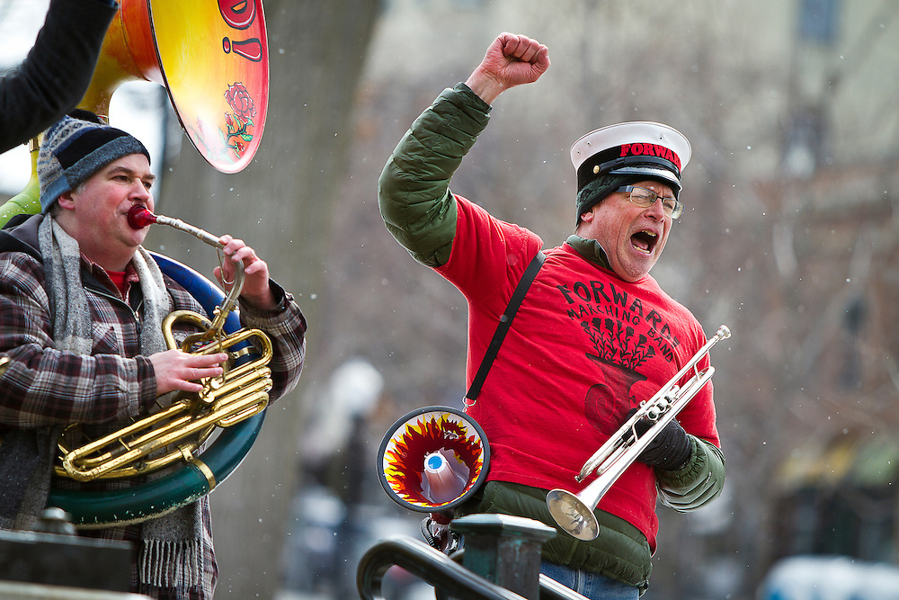 MADISON, WI — FEBRUARY 24: Members of the Forward Marching Band sing chants and rally outside the Wisconsin State Capitol on February 24, 2015. Workers and labor unions rallied in opposition to a right-to-work bill being discussed in the state legislature.
