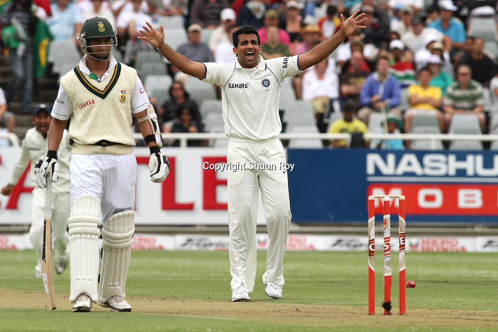 CAPE TOWN, SOUTH AFRICA - 2 January 2010, Zaheer Khan of India appeals successfully for an LBW as as Alviro Petersen of South Africa looks on during day 1 of the 3rd Castle Test between South Africa and India held at Sahara Park Newlands Stadium in Cape Town, South Africa on the 2 January 2010 .Photo by: Shaun Roy