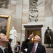 Sen. Angus King (I-ME) points to the rotunda in the U.S. Capitol, as he and his son, Angus King III, left, on Thursday January 3, 2013.  Earlier in the day King, Jr, was sworn in as a United States Senator.  John Boal photo/for the Press-Herald