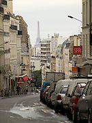 Paris street Rue de Belleville with Eiffel tower in the distance