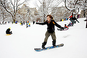 A boy snowboard  in Central Park  on January 27, 2011 in New York City..Photo by Joe Kohen for The Wall Street Journal