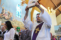 "Deacon Omar Solis enters Christ the King Church in Salinas during late morning mass on the 4th Sunday of Advent. A period of four weeks before the birth of Jesus, Advent is a time of celebration during which Western Christians prepare themselves spiritually for the Nativity. The word is derived from the Latin ""adventus,"" meaning ""arrival,"" or ""approach."" Advent is often marked by the lighting of four candles, one each week until the evening of the 24th, when a fifth one is lit, symbolizing the life of Christ."