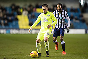 Millwall defender Shaun Cummings (2), Peterborough United forward Paul Taylor (10) during the EFL Sky Bet League 1 match between Millwall and Peterborough United at The Den, London, England on 28 February 2017. Photo by Sebastian Frej.