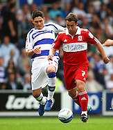 Loftus Road, London - Saturday 11th September 2010: Alejandro Faurlin (11) of QPR gets ready to tackle Scott McDonald (7) of Middlesborough during the Npower Championship match between Queens Park Rangers and Middlesborough. (Photo by Andrew Tobin/Focus Images)