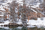 Snow falling on the shore of Gem Lake, John Muir Wilderness, Sierra Nevada Mountains, California USA