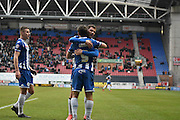 Wigan Athletic Forward, Will Grigg  congratulated by his team mates after his second during the Sky Bet League 1 match between Wigan Athletic and Bury at the DW Stadium, Wigan, England on 27 February 2016. Photo by Mark Pollitt.
