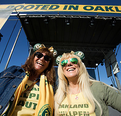Alicia Puccinelli of San Jose, left, and Ane Smith of Livermore, Calif show off their A's paraphernalia during Oakland Athletics FanFest at Jack London Square on Saturday, Jan. 27, 2018 in Oakland, Calif. (D. Ross Cameron/SF Chronicle)