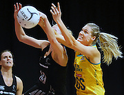 New Zealand's Casey Williams, left, and Australia's Caitlin Bassett compete for the ball in the New World Quad series netball match, Claudelands Arena, Hamilton, New Zealand, Thursday, November 01, 2012. Credit:NINZ / Dianne Manson.