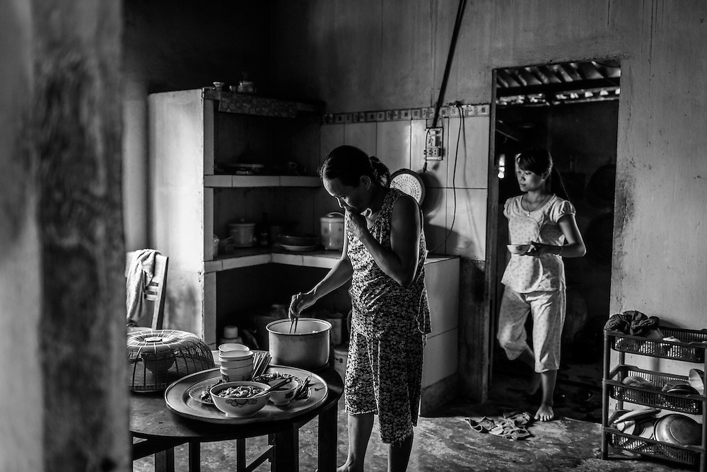 Vo Thi Nham, and her daughter Hien, prepare lunch for the family in Danang. Both of her boys, Tri 21, and Hau 14, are physially handicapped as a result of Dioxin exposure. They require full time care, and Nham worries about what will happen to them when she is no longer around. Hien, who's just graduated university knows the family's, and brothers' future is dependent on her.