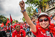 "10 DECEMBER 2012 - BANGKOK, THAILAND: A Red Shirt leader raises a clenched fist near Government House in Bangkok Monday. The Thai government announced on Monday, which is Constitution Day in Thailand, that will speed up its campaign to write a new charter. December 10 marks passage of the first permanent constitution in 1932 and Thailand's transition from an absolute monarchy to a constitutional monarchy. Several thousand ""Red Shirts,"" supporters of ousted and exiled Prime Minister Thaksin Shinawatra, motorcaded through the city, stopping at government offices and the offices of the Pheu Thai ruling party to present demands for a new charter.         PHOTO BY JACK KURTZ"