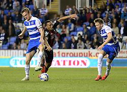 Bournemouth's Callum Wilson battles for the ball with Reading's Alex Pearce - Photo mandatory by-line: Alex James/JMP - Mobile: 07966 386802 - 14/04/2015 - SPORT - Football - Reading - Madejski Stadium - Reading v AFC Bournemouth - Sky Bet Championship