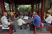 Qiongdao (Jade Island) in Beihai Lake. Locals playing tradtional Chinese music together in a pavillion.