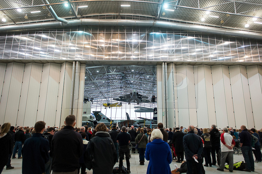 © Licensed to London News Pictures. 08/11/2015. Duxford, UK. An official service of Remembrance and wreath laying ceremony taking place in front of war planes on display in a hanger at Imperial War Museum Duxford, Cambridgeshire on Remembrance Sunday 2015. . Photo credit: Ben Cawthra/LNP