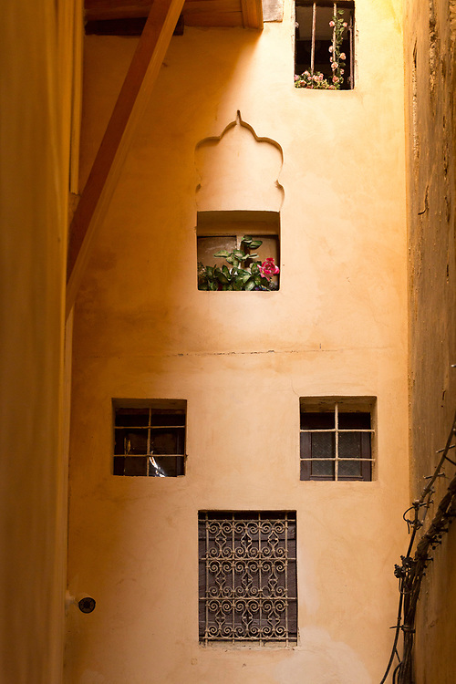 FEZ, MOROCCO 16th DECEMBER 2015 - Traditional Moroccan window shutter architecture and wall texture design, old Fez Medina, Middle Atlas Mountains, Morocco.