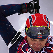 Ole Elnar Bjoerndalen of Norway prepares his rifle before the men's 15K mass start biathlon at the Laura Cross-Country Ski and Biathlon Center at the Winter Olympics in Sochi, Russia, Tuesday, Feb. 18, 2014. (Brian Cassella/Chicago Tribune/MCT)