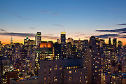 View from the penthouse of 515 East 72nd Street, of the New York City skyline at dusk, sunset, looking south-west towards the Chrysler Building.
