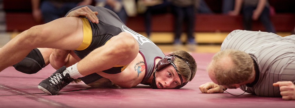 Lisa Johnston | lisajohnston@archstl.org | @aeternusphoto Cory Peterson looked to the referee as he pinned opponent Drew Doran in the first period of their match. DeSmet Jesuit High School Spartans won their wrestling match 39-26 over St. John Vianney's Griffins. This was the first time in five years they have seen victory over their rival.
