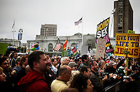 Hundreds of gay and lesbian supporters and protestors gather in front of City Hall, where county clerks stayed open late to issue marriage licenses, in San Francisco, CA, on Monday, June 16, 2008.  Same sex marriage supports meet protestors at San Francisco's City Hall as the city reopens marriage licenses to same sex couples.