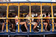 Tourists ride the Santa Teresa bonde historic tram line through the Santa Teresa neighborhood in Rio de Janeiro, Brazil.