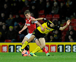Bristol City's Joe Bryan jostles for the ball with Watford's Marco Davide Faraoni - Photo mandatory by-line: Dougie Allward/JMP - Tel: Mobile: 07966 386802 14/01/2014 - SPORT - FOOTBALL - Vicarage Road - Watford - Watford v Bristol City - FA Cup - Third Round - replay