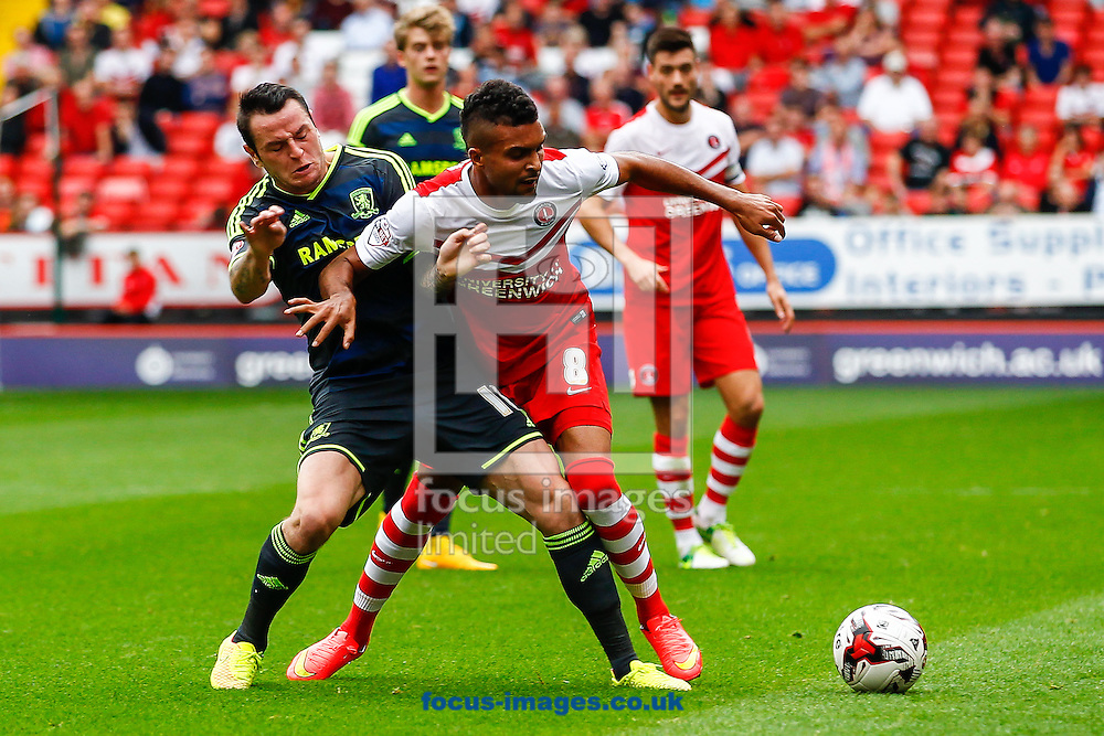 Frederic Bulot of Charlton Athletic (right) is fouled by Lee Tomlin of Middlesbrough during the Sky Bet Championship match at The Valley, London<br /> Picture by David Horn/Focus Images Ltd +44 7545 970036<br /> 27/09/2014