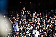 Oakland Raiders fans celebrate a touchdown against the Tennessee Titans at Oakland Coliseum in Oakland, Calif., on August 26, 2016. (Stan Olszewski/Special to S.F. Examiner)