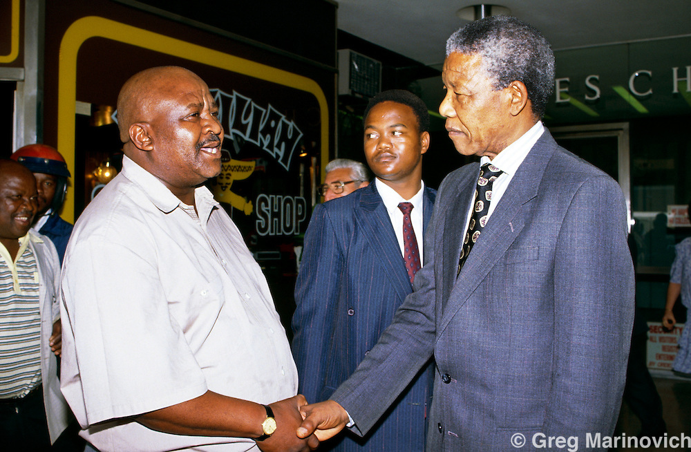 Nelson Mandela, ANC leader greets a wellwisher outside the Johannesburg High Court. South Africa. 1991-1993.