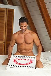 nude hot man in bed with a pizza box
