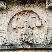 A carving of a Mayan king in the wall of one of the buildings at Chichen Itza Mayan Ruins in Mexico's Yucatan Peninsula