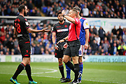Bolton's Marc Wilson is shown the red card by referee Stephen Martin during the EFL Sky Bet Championship match between Ipswich Town and Bolton Wanderers at Portman Road, Ipswich, England on 22 September 2018.