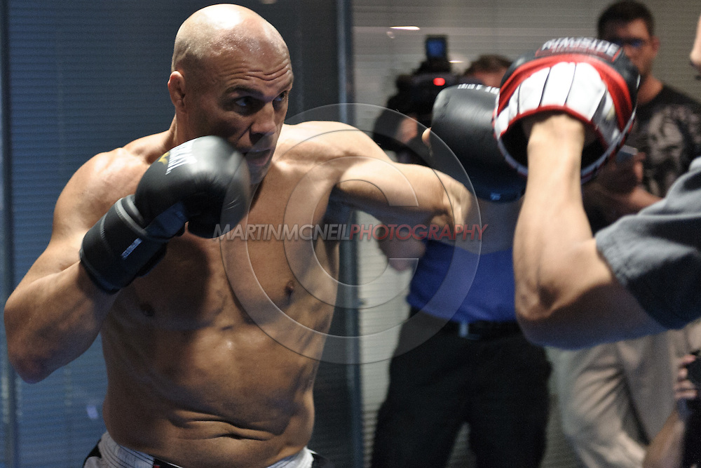 MANCHESTER, ENGLAND, NOVEMBER 11, 2009: Randy Couture performs focus mitt striking drills during the open work-outs for UFC 105 at the Crowne Plaza Hotel in Manchester, England on November 11, 2009.