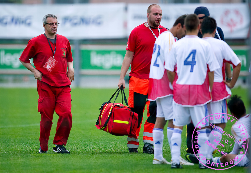 Jacek Ciekalski - medical doctor while SO Austria (red) and SO Romania (white) soccer match during the 2013 Special Olympics European Unified Football Tournament in Warsaw, Poland.<br /> <br /> Poland, Warsaw, June 07, 2012<br /> <br /> Picture also available in RAW (NEF) or TIFF format on special request.<br /> <br /> For editorial use only. Any commercial or promotional use requires permission.<br /> <br /> <br /> Mandatory credit:<br /> Photo by © Adam Nurkiewicz / Mediasport